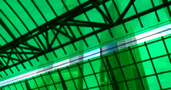 Through the green glass roof of the station visible skyscrapers Stock Footage
