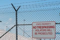 State property no trespassing sign violators will be persecuted sign Stock Photos