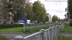 Tram runs along single-track fenced segregation in Sosnovaya Polyana Stock Footage