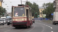 Traditional old tram runs along Sredneokhtinsky Prospekt Stock Footage