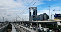 Railroad tracks, two tiers a busy highway, high-rise buildings Stock Footage