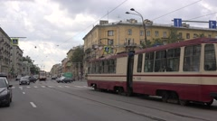 Oncoming trams meet in mixed traffic at Sredneokhtinsky prospekt Stock Footage