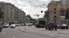 Old tram passes a curve in mixed traffic at Sredneoktinsky prospekt Stock Footage