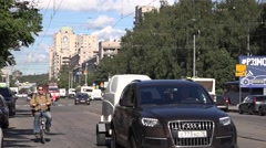 Car, bus, bike and tram multi-mode traffic at Torzhkovskaya Street Stock Footage