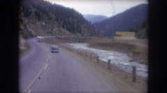 1962: car between mountains. COLORADO Stock Footage