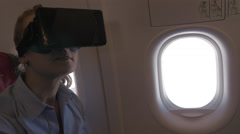 Woman exploring virtual world during the flight Stock Footage