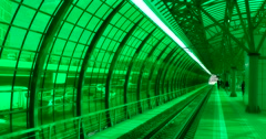 Platform of the train, behind the green glass wall, the traffic on the motorway Stock Footage