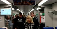 A lot of young passengers enter the subway car Stock Footage