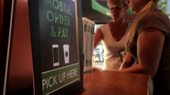 Motion of mobile order and pay sign beside that people waiting their coffee Stock Footage