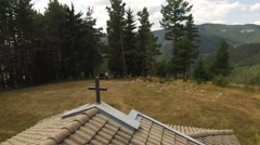 From church cross to mountain panorama Stock Footage