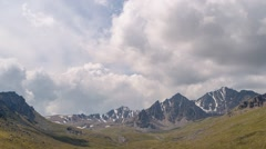The clouds over the peaks of Kyrgyzstan. Time Lapse Stock Footage
