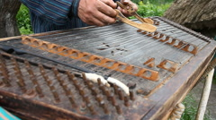 Musician plays the old Ukrainian dulcimer Stock Footage