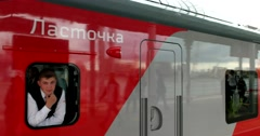 Train driver looks out the window, the train departs from the platform Stock Footage
