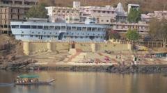 Boat with pilgrims on Narmada river,Omkareshwar,India Stock Footage
