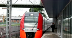 Railway workers, the train arrives at the station on the outskirts of town Stock Footage