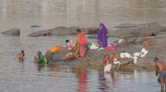 Pilgrims washing in Narmada river,Omkareshwar,India Stock Footage