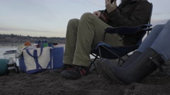 Bearded Man Plays Guitar, Woman Taps Her Feet To The Beat Stock Footage