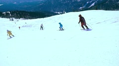 Russia, Sheregesh, 26 march 2015, People skiing downhill in slowmotion, snow Stock Footage