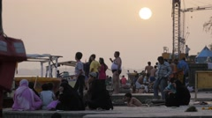 Pilgrims on ghats at sunset,Maheshwar,India Stock Footage