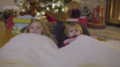 Cute Kids Listen To Story Under Christmas Tree, Excited For Christmas Day Stock Footage