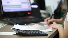 Office worker working at a computer in the workplace Stock Footage
