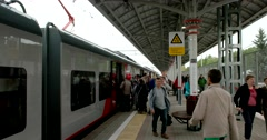 The train on the platform, the doors of the cars opened, people go out Stock Footage
