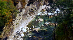 4K Mountain Riverbed, Water Streaming through Forest Rock Landscape Stock Footage