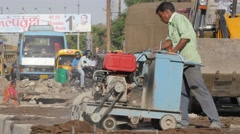 Construction worker cutting asphalt,Indore,India Stock Footage