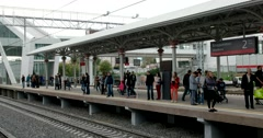 People on the platform waiting for the arrival of the train, view from  opposite Stock Footage