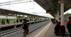 Passengers on the platform waiting for the train's arrival Stock Footage