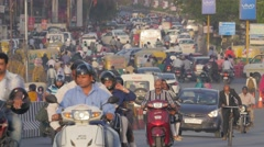 Street with busy traffic with cyclist in suit,Indore,India Stock Footage