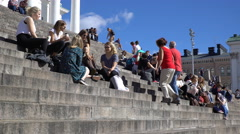 Many young people sit on the steps in front of the Cathedral in Helsinki. Stock Footage
