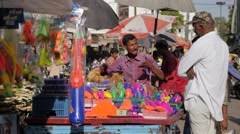 Seller of coloured powder for Holi festival,Ujjain,India Stock Footage