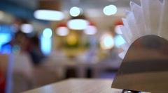 Abstract coffee shop, soft and blur concept. Paper napkins in the foreground Stock Footage