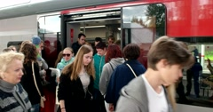Train doors open, passengers enter and exit Stock Footage