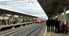 The train arrived on the platform, many passengers at the station Stock Footage