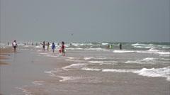 Beachgoers Enjoying the Beach on South Padre Island, Texas Stock Footage