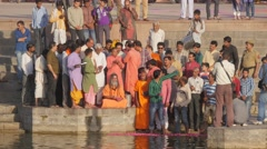Ceremony with hindu priest throwing petals in river,Ujjain,India Stock Footage