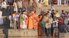 Ceremony with hindu priest throwing coloured powder in river,Ujjain,India Stock Footage