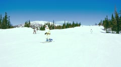 Russia, Sheregesh, People skiing downhill in slowmotion, snow Stock Footage