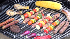 Skewered meat and vegetables on the barbecue grill Stock Footage