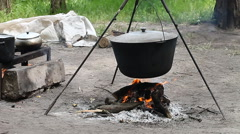 Bowler camp , cooking on a fire Stock Footage