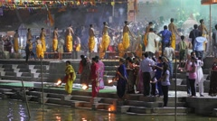 Priests and pilgrims swinging candles,Ujjain,India Stock Footage