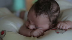 Baby infant is try raises head, lying at the bed Stock Footage