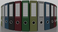 Rotating multicolored office binders, shallow focus. 4K seamless loopable Stock Footage