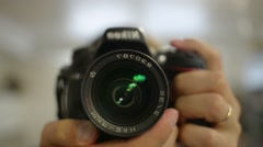 Camcorder Operator Adjusts The Focus Of The Lens Nikon D610 Stock Footage