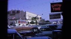 1963: this street crossing while busy, shows the jai alai sports center in town. Stock Footage