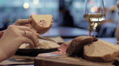 Woman eating bread with meat paste in the cafe Stock Footage