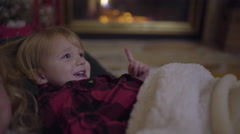 Children Snuggling By Cozy Fireplace, Listening To Christmas Stories Stock Footage