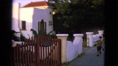 1963: children running free past the garden gate. BARRINGTON, ILLINOIS Stock Footage